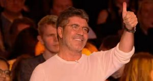 simon cowell bouton or gold button
